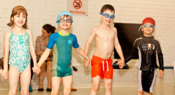 4 children taking part in a Club swimming lesson