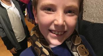 Edward handling a snake at the YMCA Club Playscheme