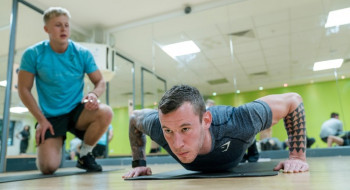 Personal Trainer supervising one of his clients