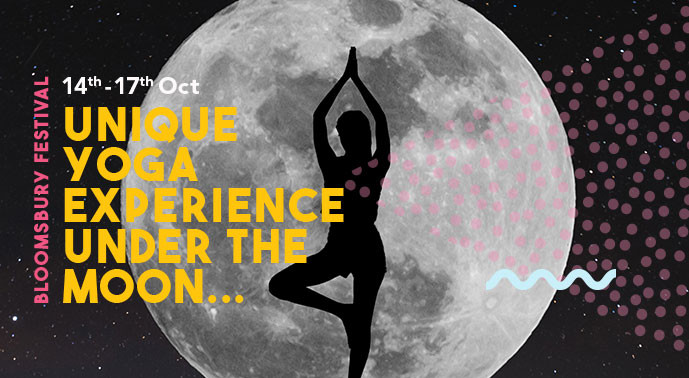 person doing yoga in front of the moon