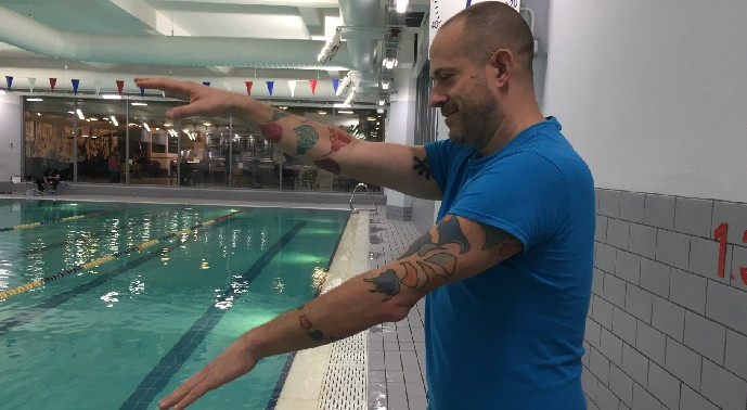 Volunteer Swimming Teacher, Marc, demonstrating technique at the YMCA Club's pool for Positive Strokes
